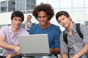 Students at college campus with laptop computer